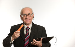 Old businessman with tablet computer stock images
