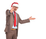 Old businessman wearing santa claus hat presenting and making ok Royalty Free Stock Photos