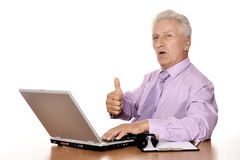 Old businessman working. With notebook isolated on white background Royalty Free Stock Photos