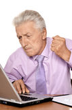 Old businessman working with notebook Royalty Free Stock Photo