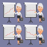 Old Businesswoman Points on Flip Chart Royalty Free Stock Image