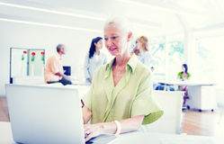 Old Businesswoman Working in the Office Royalty Free Stock Image