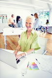 Old Businesswoman Working in the Office Stock Image