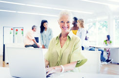 Old Businesswoman Working in the Office Stock Photography