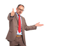 Old bussinessman presenting and making the ok sign Stock Images