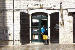 Old butcher shop at the village of Agnone. Old butcher shop with typical wooden entrance in the medieval village of Agnone. Molise region, central south Italy stock photography