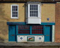 Old Butchers Shop fronted with decorative Tiles stock photography