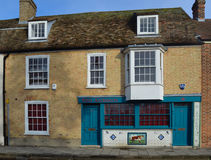 Old Butchers Shop fronted with decorative Tiles Royalty Free Stock Image