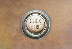 Old button - click here Stock Images