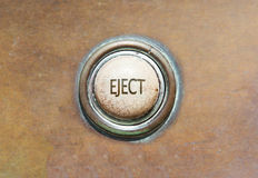 Old button - eject. Grunge image of an old button - eject Stock Image