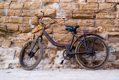 Old Bycicle. Against a brick wall in Morocco Royalty Free Stock Photography