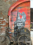Old bycicle. Vintage bicycle against an old worn door Stock Photos