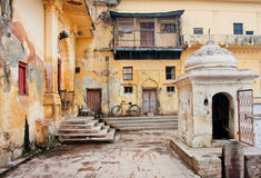 Old bycicle stands in the courtyard of poor house Stock Photo