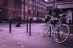 Old bycicle on the steet of citty Stock Photos