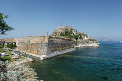 Old Byzantine fortress in Corfu. Famous touristic landmark old venetian fortress with walls going to sea and clock tower in the morning, located at Kerkyra city Royalty Free Stock Photography