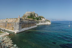 Old Byzantine fortress in Corfu. Famous touristic landmark old venetian fortress with walls going to sea and clock tower in the morning, located at Kerkyra city Stock Photo