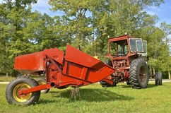 Old cab tractor pilling a hay conditioner Royalty Free Stock Photos
