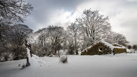 The old cabin. An abandoned cabin in the snow Stock Photo