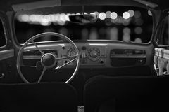 Old cabin, console and steering wheel in a vintage retro car. Ni stock photography