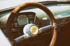 Old cabin, console and steering wheel in a vintage retro car. Retro toning vintage style image Stock Images