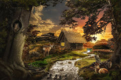 Old cabin. Old decrepit house near a stream at sunset in the fabulous valley Stock Image