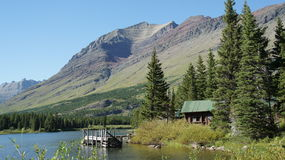 An old cabin and dock on the shores of Hidden Lake. Stock Photos