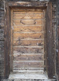 Old cabin doorway with falling snow Stock Photography
