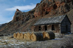 Old cabin & hay bales. Royalty Free Stock Photo