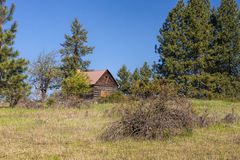 Old cabin on the hill. Stock Photos