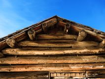Old Cabin Roof Logs and Blue Sky Stock Images
