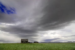 Old cabin with storm clouds Royalty Free Stock Photo