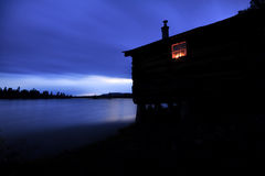 Old cabin after Sunset Stock Photos