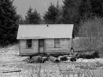 Old cabin at the tide line Stock Photo