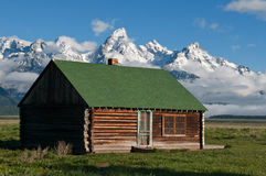Old Cabin Under Mountains Royalty Free Stock Photo