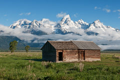 Old Cabin Under Mountains Royalty Free Stock Image
