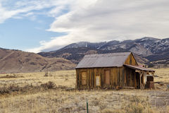 Old cabin in a valley Stock Photo