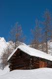 Old cabin on a wonderful sunny winter day. Stock Photography