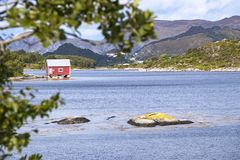 Old cabins, boathouses, Island Nautoya, Norway stock photos