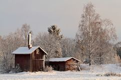 Old cabins in Finland s winter landscape Royalty Free Stock Photos