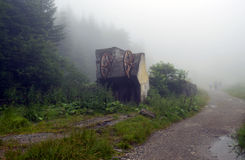 Old cable cabin with an early morning fog Stock Photo