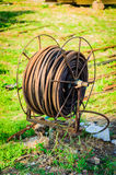 Old Cable Reel. An old and rusty cable roller in an open air boat construction workplace Stock Images