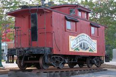 Old Caboose Car. Railroad Caboose used many years ago on display in a small Town and is used as advertising a small city shopping mall Royalty Free Stock Photos