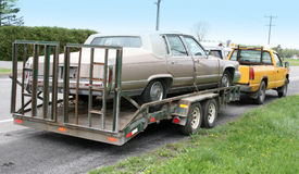 Old cadillac towed by truck Royalty Free Stock Photos
