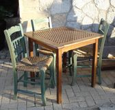 Old Cafe. Table with tree chairs royalty free stock photography