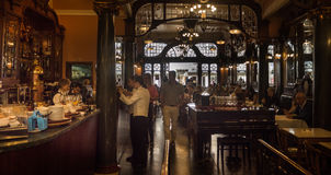 Old cafe in Europe with wood and brass decor. Majestic Cafe in Porto, Portugal. Dark interior, wood & brass, vintage cafe Stock Photo