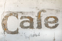 Old Cafe sign on building Stock Photography