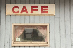 Old cafe sign on closed restaurant building Royalty Free Stock Photos