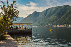 The old cafe on the water. Is the favorite tourist place with delicious local cuisine and nice view on Kotor bay, Perast, Montenegro Stock Images