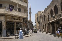 Man walks in a street of Old Cairo, Egypt. Old Cairo street, Egypt, June 2013: Life runs normally in the streets of Cairo during the previous days to the Royalty Free Stock Photography