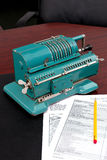 Old calculator. Arithmometer which carried out functions of the calculator earlier Stock Image